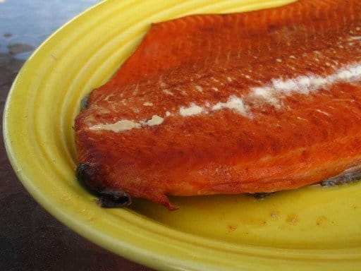 Grill smoked salmon on a yellow platter