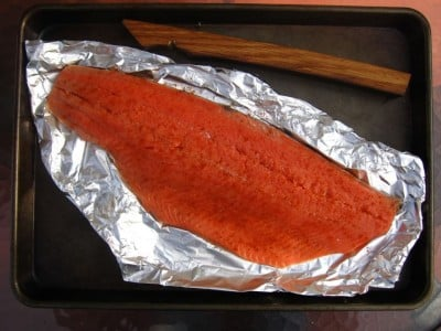 Side of salmon on a piece of aluminum foil