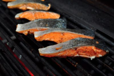 Salmon filets on the grill, flesh side down