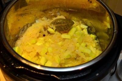 Stir in the sauerkraut and apples