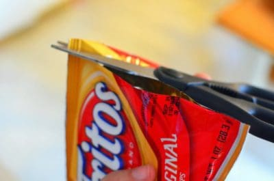 Cut open the bag - it's easier to eat if you cut lenthwise