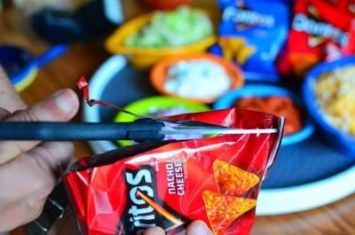 Cut open the Doritos bag lengthwise for easier scooping