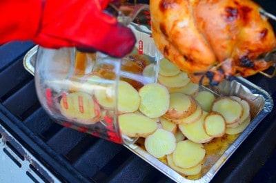Adding potatoes to the drip pan