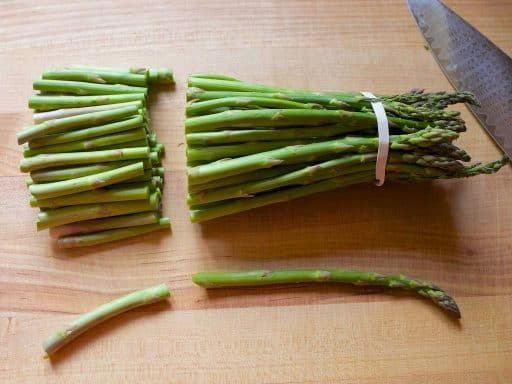 Trimming the woody ends of the asparagus spears | DadCooksDinner.com