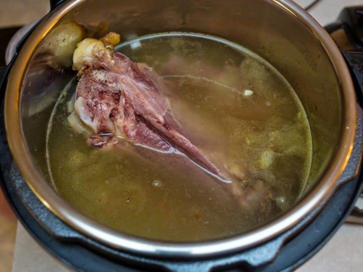 Ham bone and water in Instant Pot   DadCooksDinner.com
