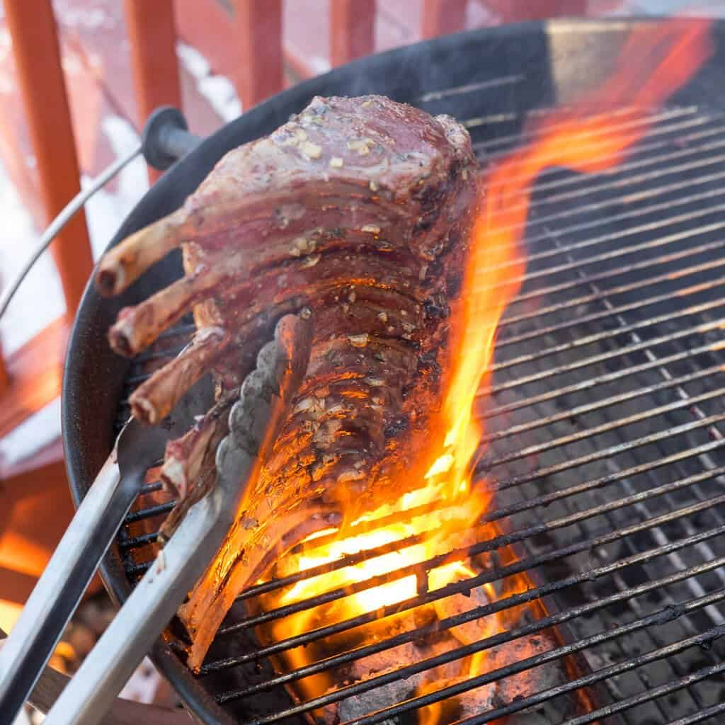 Rack of lamb on a grill with a big flareup | DadCooksDinner.com