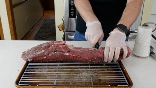 Cut the roast in half