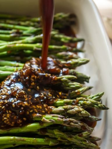 Pouring teriyaki sauce on asparagus | DadCooksDinner.com