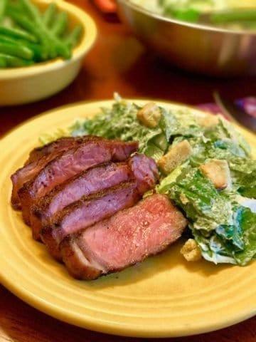 Grilled New York Strip Steaks with Caesar Salad | DadCooksDinner.com