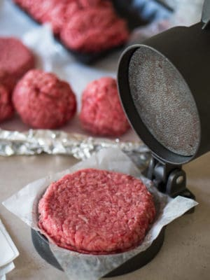 Using a hamburger press to make the burger patties - Jalapeno Cheeseburgers With Grilled Onions | DadCooksDinner.com