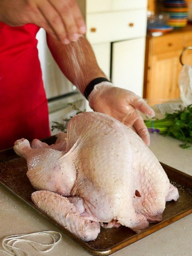 Sprinkling salt on the Thanksgiving turkey | DadCooksDinner.com
