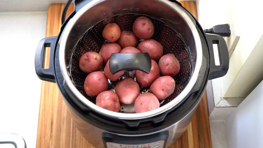 Baby potatoes in a steamer basket in an Instant Pot