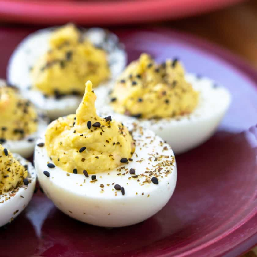 Wasabi deviled eggs on a purple plate
