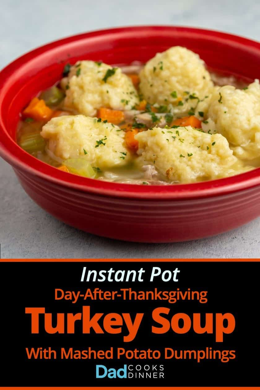 A red bowl of Turkey Soup with Mashed Potato Dumplings on a white background