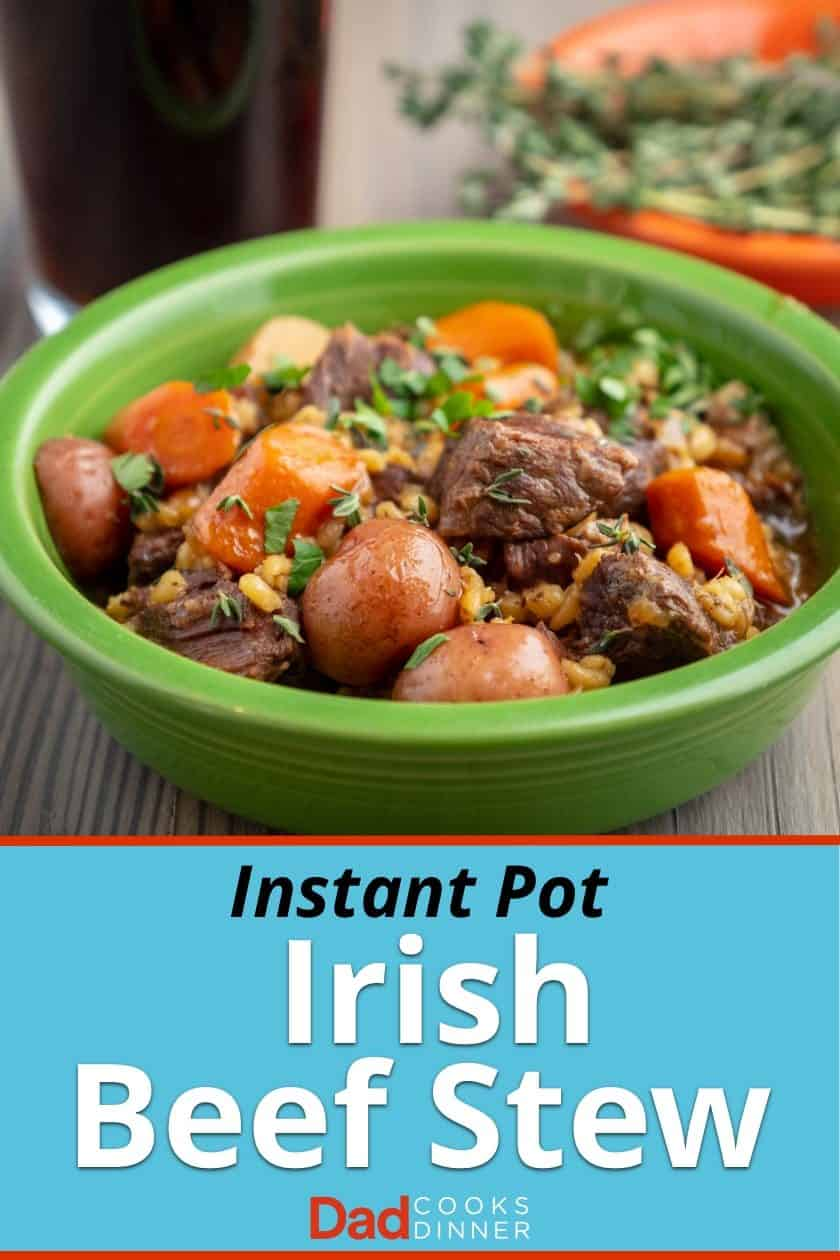A green bowl full of beef stew with potatoes, carrots and barley; sprinkled with parsley and thyme leaves, with a glass of stout and a bowl of thyme in the background