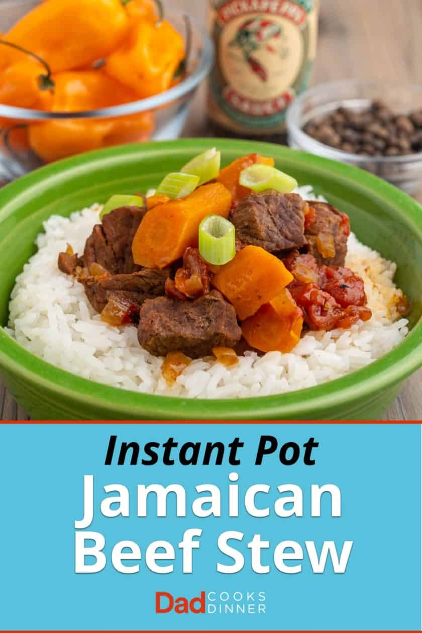 Beef stew with carrots, tomatoes, and green onions, on top of a bed of rice, in front of a bowl of scotch bonnet peppers, pickapeppa sauce, and allspice