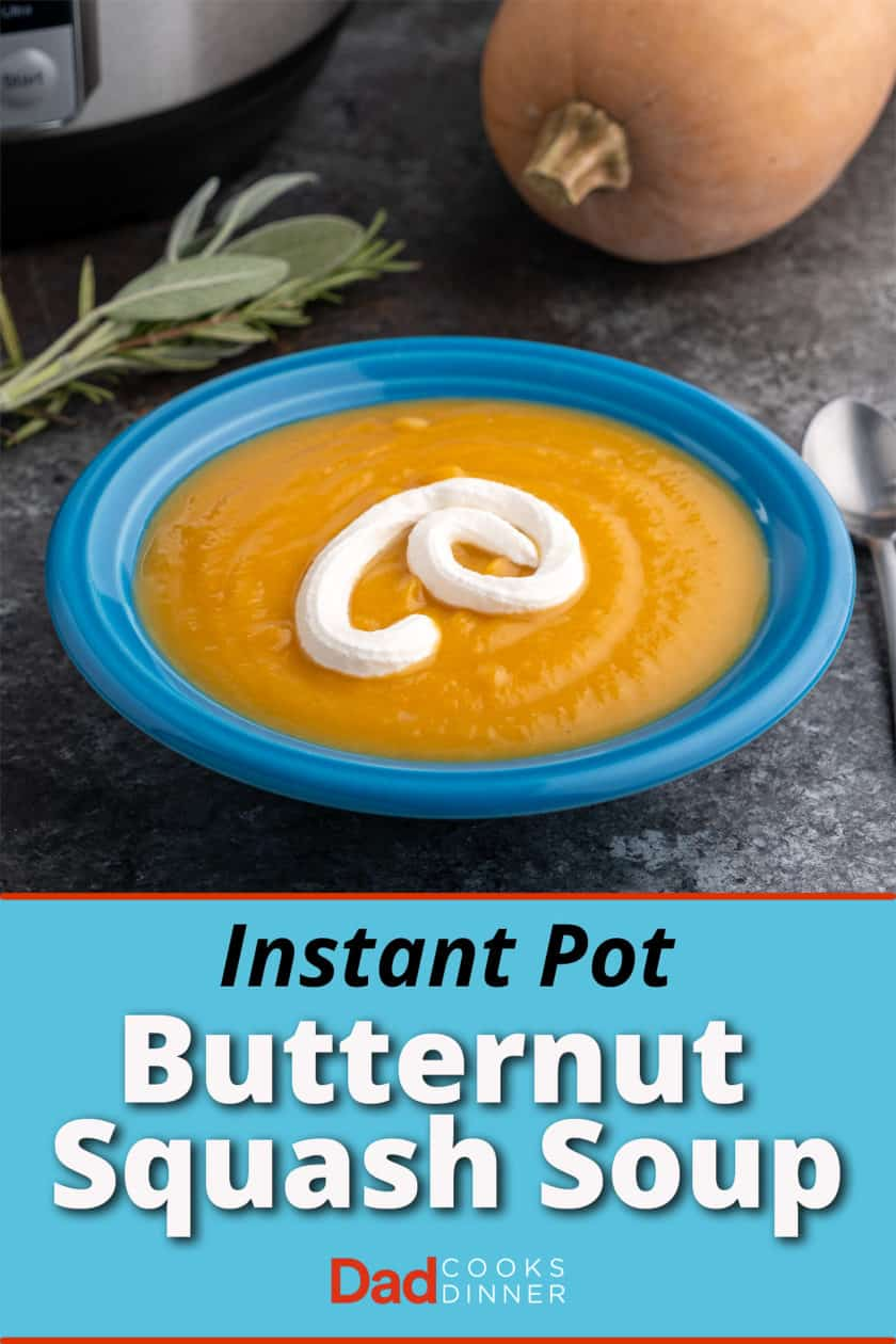 A blue bowl of squash soup with a drizzle of sour cream, with a bundle of herbs, a squash, and an Instant Pot in the background