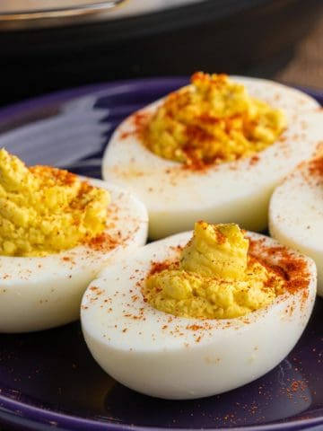 Deviled eggs, sprinkled with paprika, on a plate