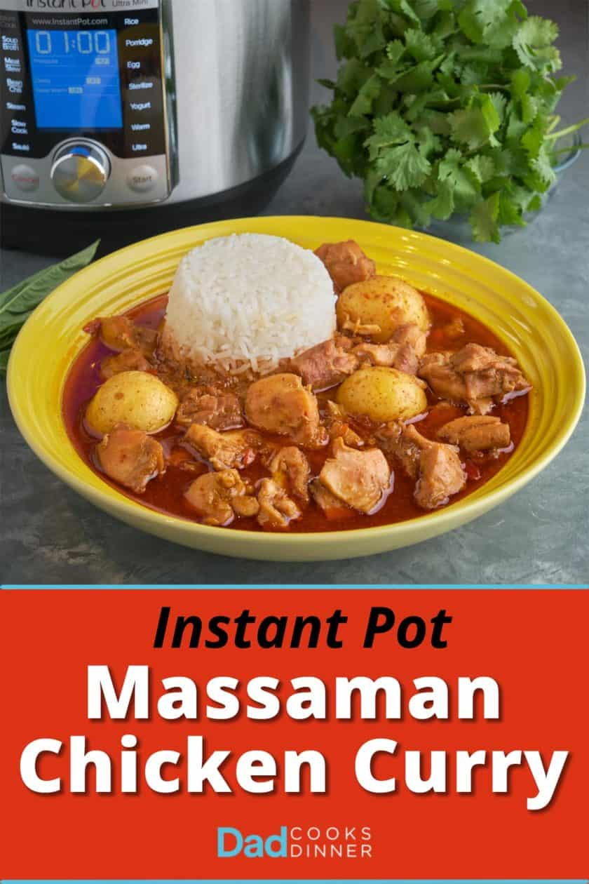A yellow bowl of massaman chicken curry with a serving of rice, on a gray table with basil, cilantro, and an Instant Pot visible in the background