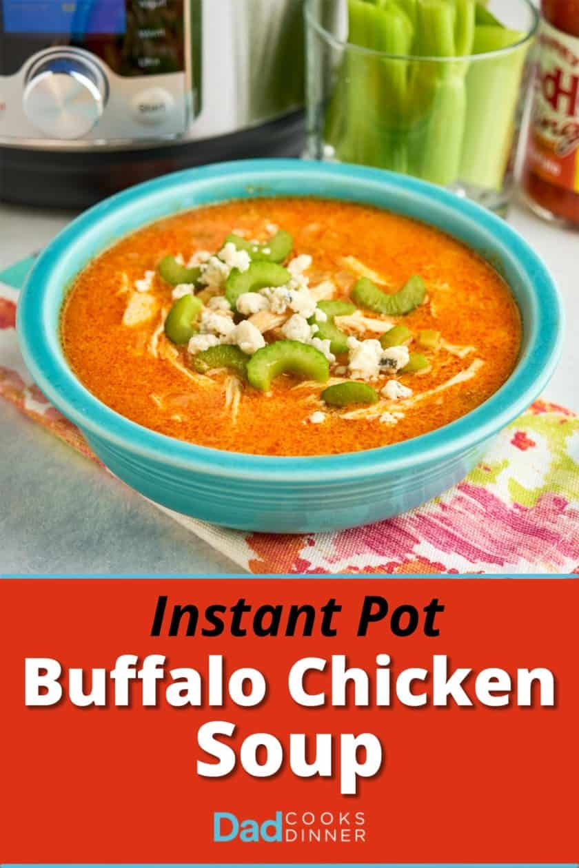 A bowl of Buffalo chicken soup topped with celery and blue cheese crumbles, with an Instant Pot and celery sticks in the background.