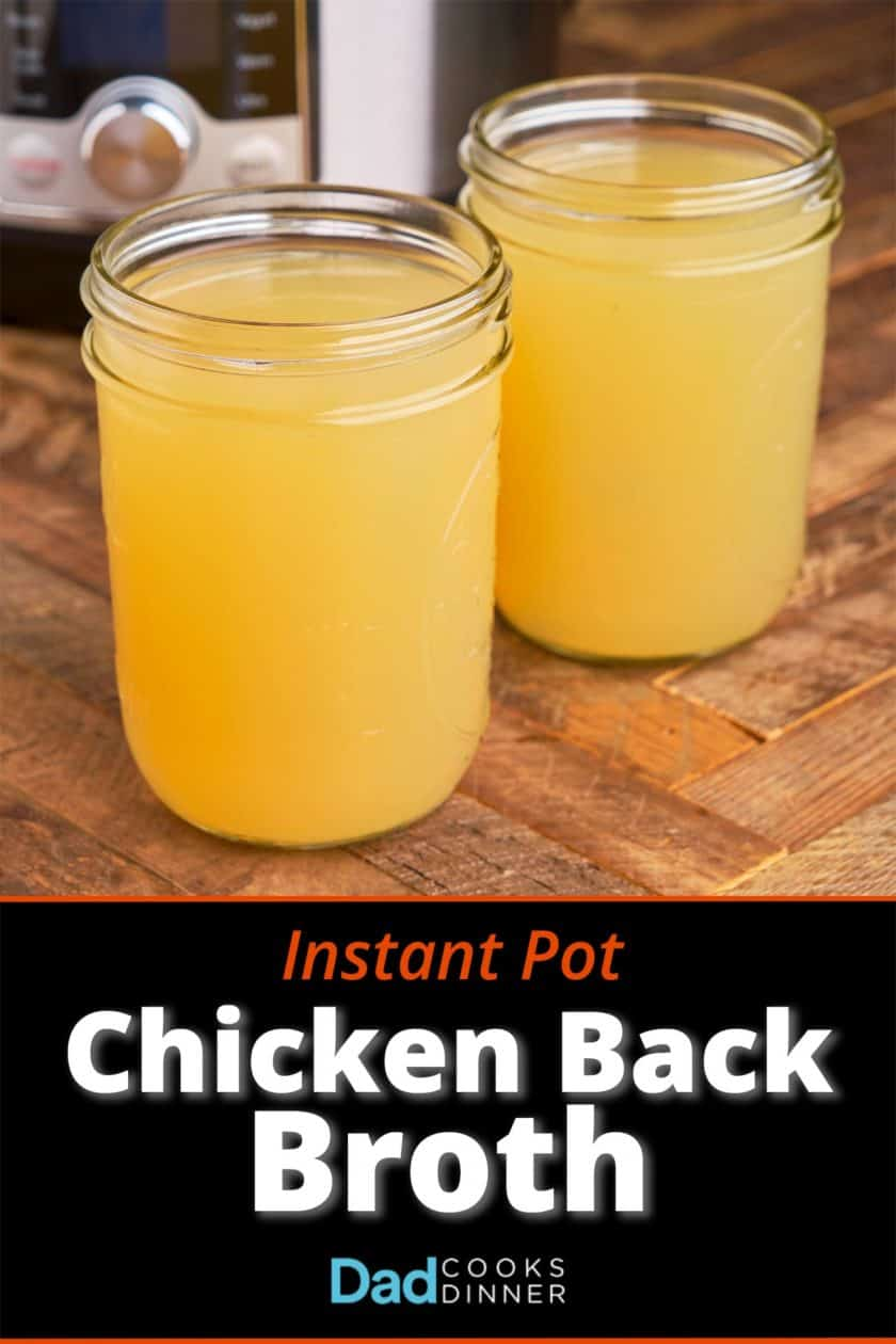 Two jars of chicken broth on a wood table in front of an Instant Pot