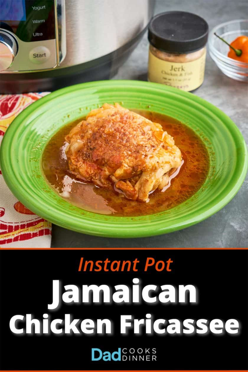 A chicken thigh in Jamaican jerk chicken fricassee sauce, on a green plate, in front of an Instant Pot, a jar of Jerk seasoning, and a Scotch Bonnet pepper