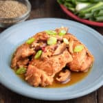 A plate of Chicken with Shiitake mushrooms, Sesame seeds and green onions