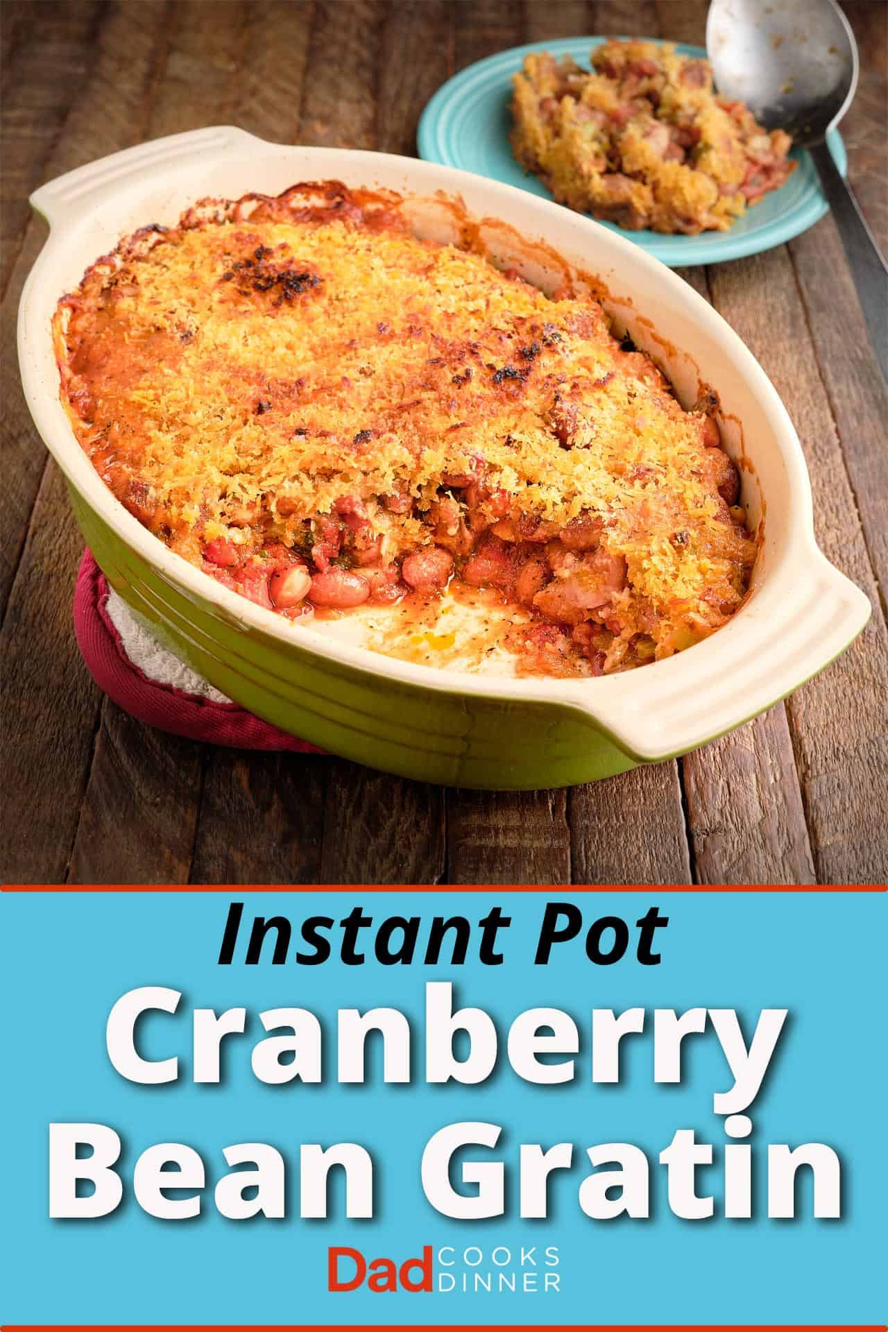A baking dish of cranberry bean gratin, with a serving scooped out, and a plate with a scoop and some of the gratin in the background