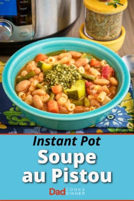 A bowl of Provencal pesto soup in front of an Instant Pot and a jar of spices