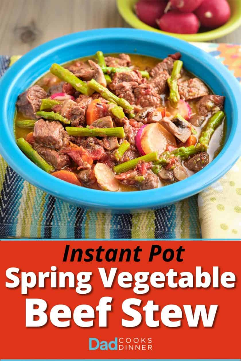 A bowl of beef stew with asparagus, carrots, and radishes.