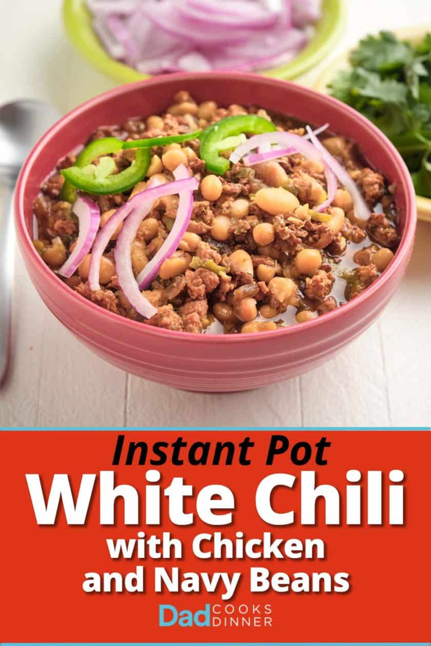 A bowl of white chili with sliced onions and jalapeños on top